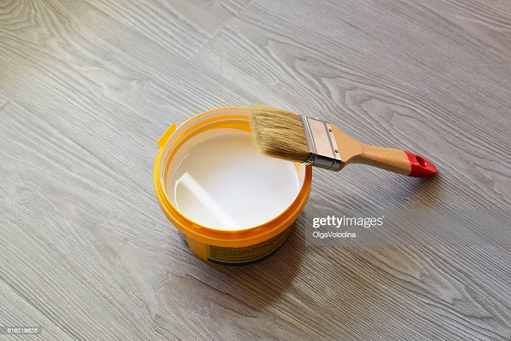 Bank with white paint and brush on  floor : Stock Photo