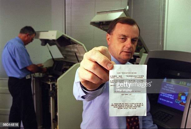 Bank Year 200 software manager Alan Barber in the ATM and eftpos terminal Y2K testing room with a year 2000 receipt