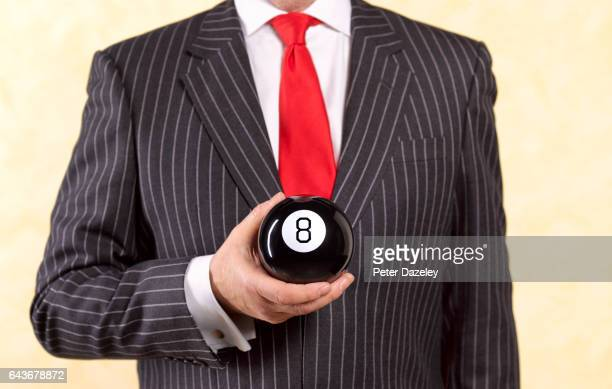 Banker businessman behind the eight ball