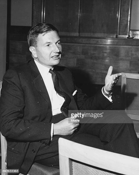 Banker David Rockefeller Chairman of the Chase Manhattan Corporation pictured in conversation at the Savoy Hotel during the Chase Investment Forum...