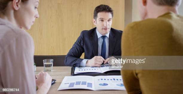 Banker discussing with couple