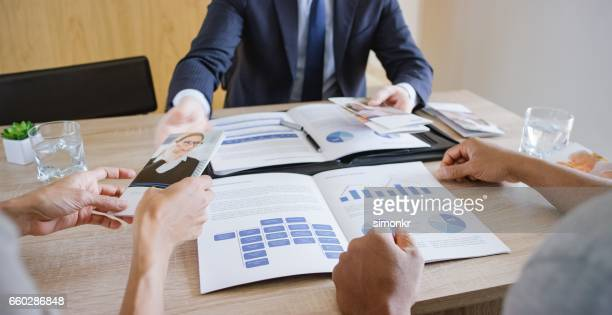 banker discussing with couple - flyer leaflet stock photos and pictures