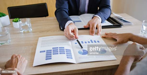 banker discussing with couple - information equipment stock pictures, royalty-free photos & images