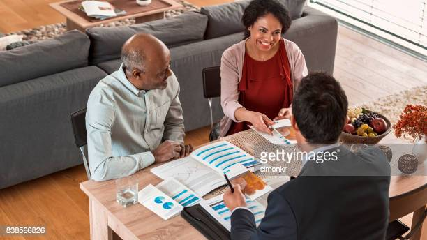 Banker discussing with mature couple