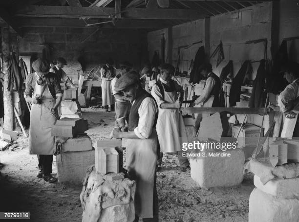 'Banker' masons carve pieces of Bath stone at a quarry in Corsham Wiltshire 24th October 1928