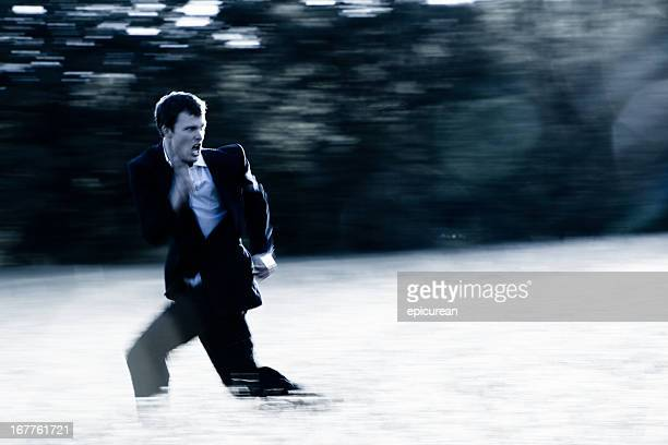 banker on the run - rushing the field stock pictures, royalty-free photos & images