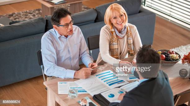 Banker shaking hands with woman
