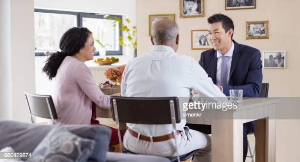 Banker visiting mature couple'n