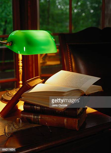 Banker's Lamp and a Stack of Books