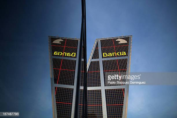 Bankia building at Plaza de Castilla is reflected on a window glass on December 3 2012 in Madrid Spain Spain has formally requested 395 euro billions...