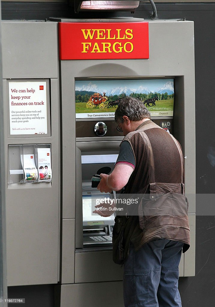 A banking customer uses an ATM at a Wells Fargo Bank branch on July 19, 2011 in Oakland, California. San Francisco-based Wells Fargo & Co. reported a 30 percent surge in quarterly profits with earnings of $3.73 billion, or 70 cents per share compared to $2.88 billion, or 55 cents per share one year ago.