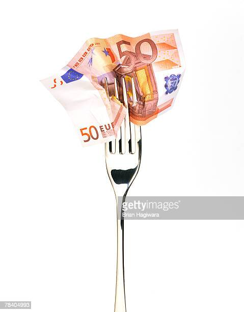 Banknote and fork