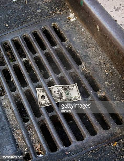 US banknote caught in drain
