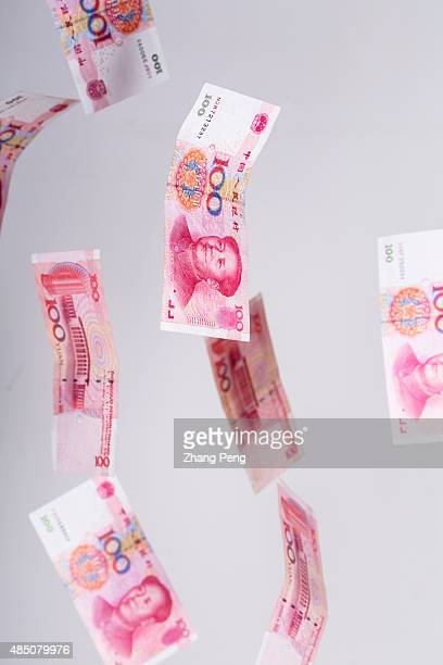 RMB banknotes falling down in midair arranged for photograph China's recent devaluation of the RMB has created waves in domestic and global markets