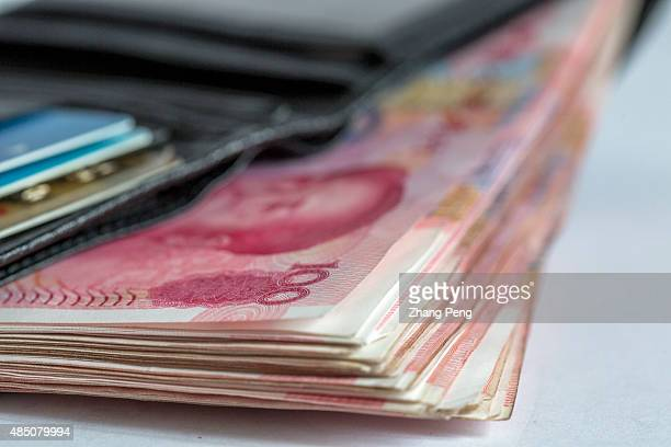 RMB banknotes in a wallet arranged for photograph China's recent devaluation of the RMB has created waves in domestic and global markets