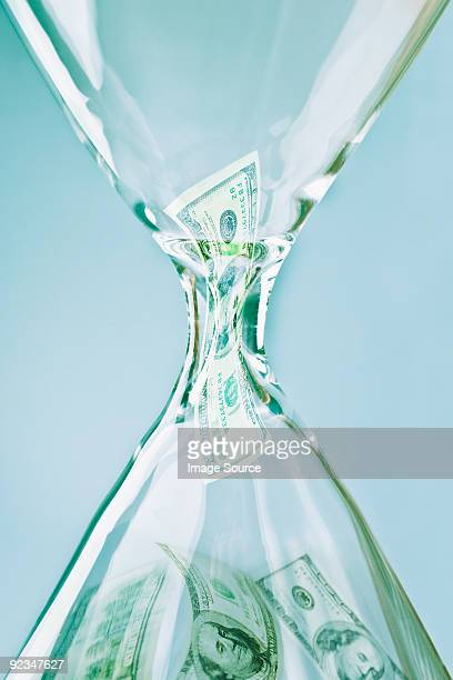 Banknotes in an hourglass