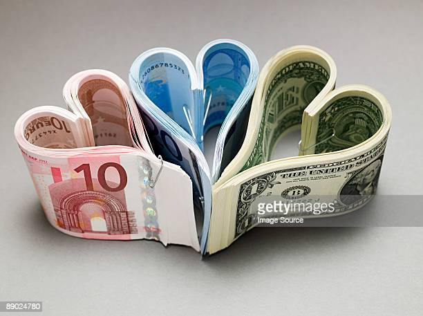 banknotes in heart shapes - twenty euro banknote stock photos and pictures