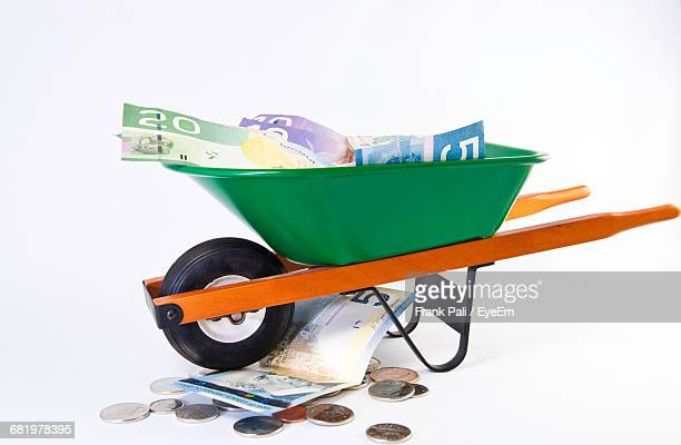 Banknotes In Wheelbarrow