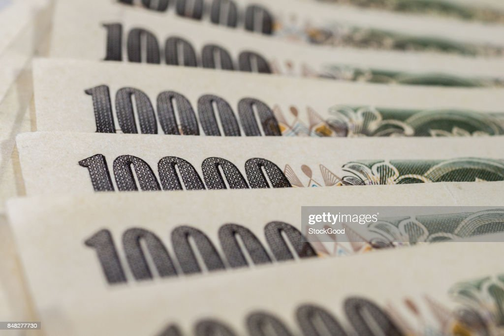 Banknotes of Japanese yen currency background : Stock Photo