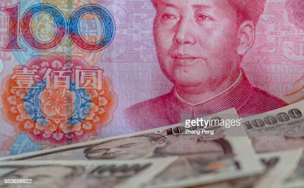 Banknotes of RMB and Yen arranged for photography Rises in the yuan/yen exchange rate partially offset the devaluation of RMB versus US dollar which...