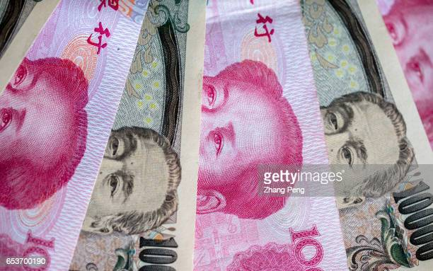 Banknotes of RMB and Yen, arranged for photography. Rises in the yuan/yen exchange rate partially offset the devaluation of RMB versus US dollar,...