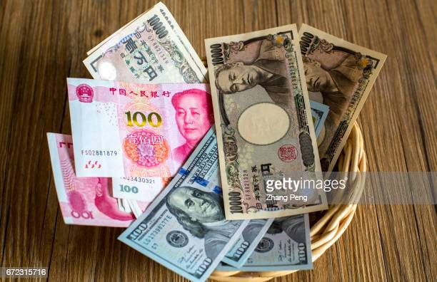 Banknotes of RMB Japanese Yen and US Dollar arranged for photography On December 29 China Foreign Exchange Trade System announced a new way to...