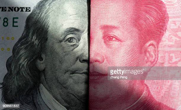 Banknotes of US Dollar and RMB are arranged for photography Recently the exchange rate of RMB vs US Dollar has continued to rise sharply The forecast...
