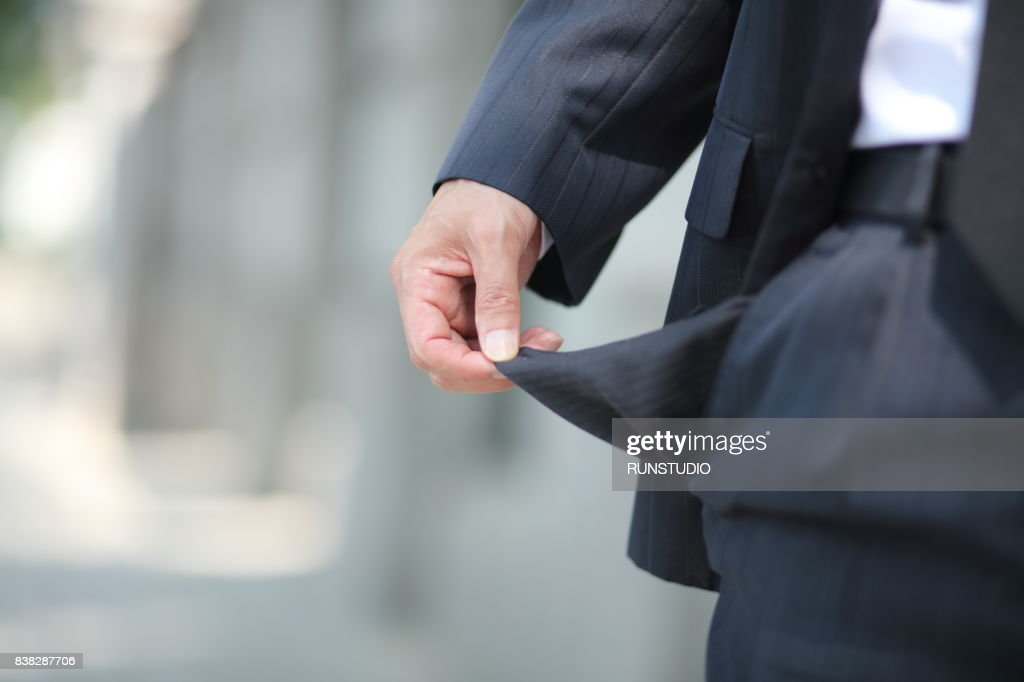 Bankrupt, close-up of man's empty pocket : Stock Photo