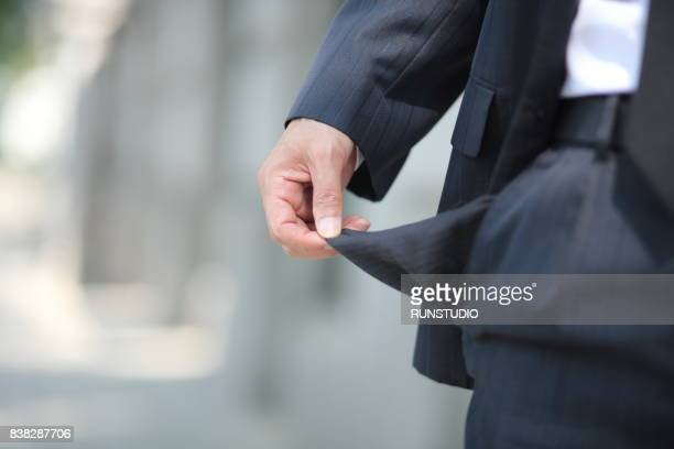 bankrupt, close-up of man's empty pocket - pocket stock pictures, royalty-free photos & images