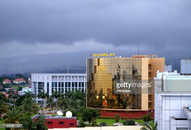 ccei bank's golden facade and the cemac parliament, malabo, equatorial guinea - malabo stock pictures, royalty-free photos & images