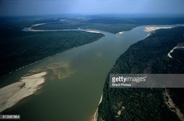 Banks of the Araguaia river showing sand slopes fluvial beach or river beach at Ilha do Bananal the world´s largest fluvial island Amazon rainforest...