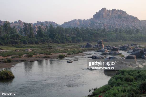 banks of the tungabhadra river, rocky hills of hampi, india - argenberg stock pictures, royalty-free photos & images