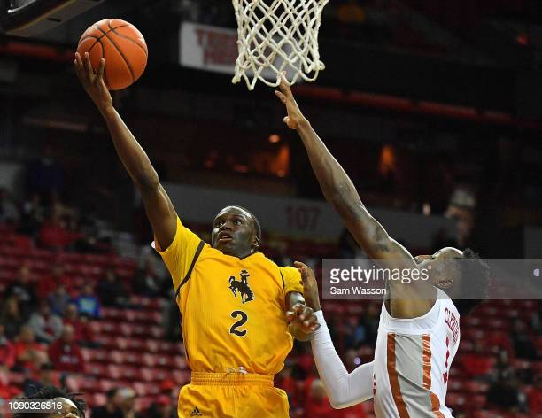 J Banks of the Wyoming Cowboys scores on a layup against Kris Clyburn of the UNLV Rebels during their game at the Thomas Mack Center on January 05...