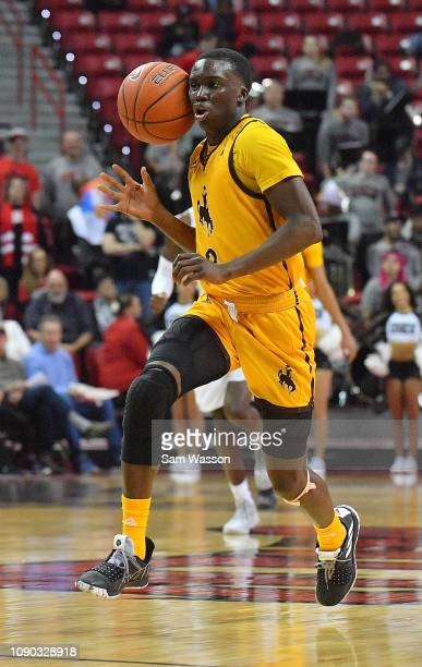 J Banks of the Wyoming Cowboys tries to control the ball against the UNLV Rebels during their game at the Thomas Mack Center on January 05 2019 in...
