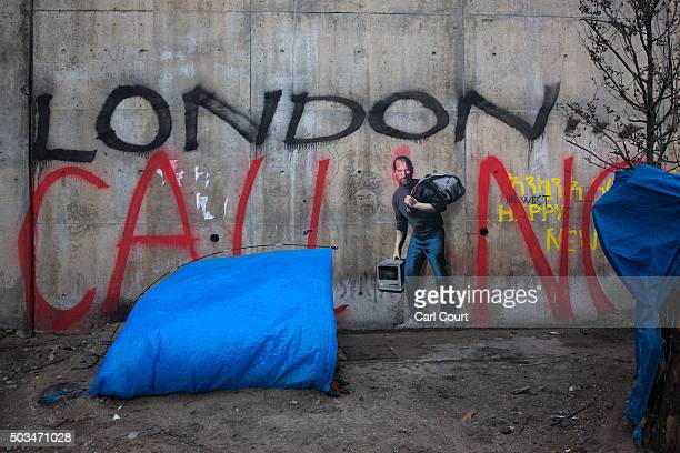 Banksy artwork featuring Apple founder Steve Jobs is pictured in the camp known as 'The Jungle' on January 5, 2016 in Calais, France. Thousands of...