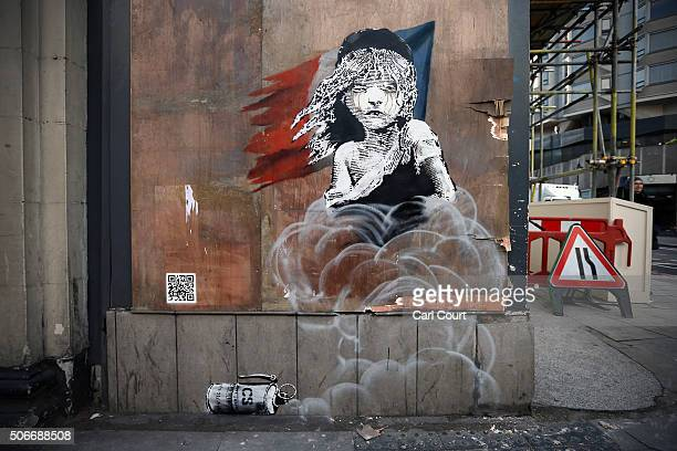 Banksy artwork is pictured opposite the French embassy on January 25 2016 in London England The graffiti which depicts a young girl from the musical...