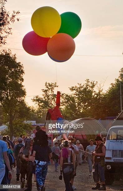 Banksy unravels the string of his famous balloon girl at Glastonbury Festival 2005
