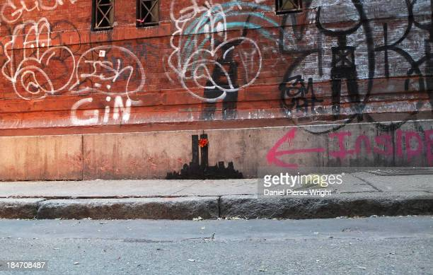 Banksy's latest work depicting the New York City skyline with the former World Trade Center Twin Towers is shown October 15 2013 in the Tribeca...