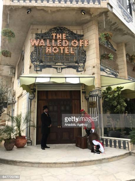 Banksy's newly opened 'The Walled Off' hotel is seen next to the controversial Israeli separation wall in the West Bank town of Bethlehem on March 3...