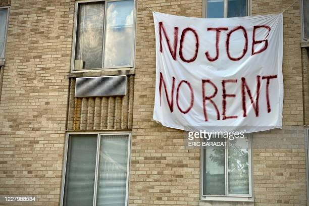 Banner against renters eviction reading no job, no rent is displayed on a controlled rent building in Washington, DC on August 9, 2020. - With double...