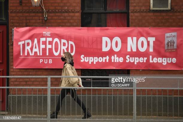 Banner against the proposed European Super League hangs from a pub close to Manchester United's Old Trafford stadium in Manchester, northwest England...