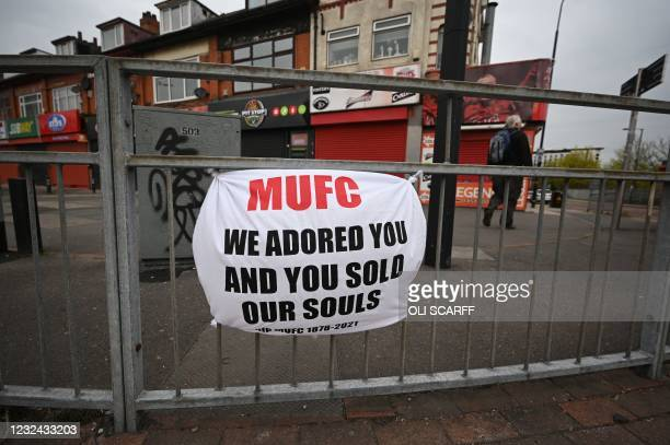 Banner against the proposed European Super League hangs from railings close to Manchester United's Old Trafford stadium in Manchester, northwest...