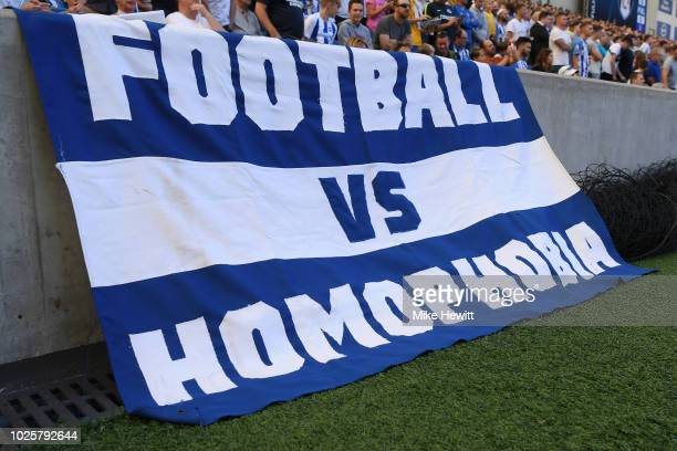 A banner agaist homophobia is displayed inside the stadium by fans prior to the Premier League match between Brighton Hove Albion and Fulham FC at...