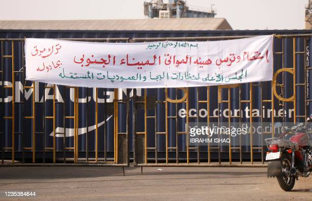 Banner announcing in Arabic the sit in and blockade of the southern port is pictured at the main entrance to the southern port in Port Sudan on...