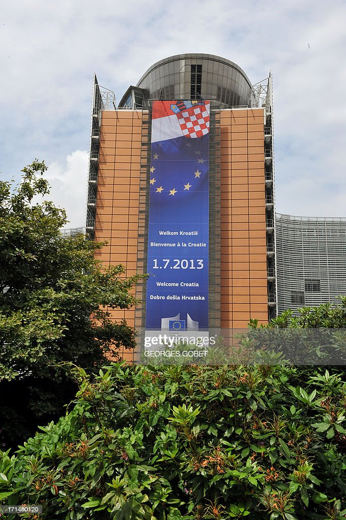 A banner announcing the arrival of Croatia into the EU is seen hanging on a main wall of the Berlaymont building at the EU Headquarters in Brussels on June 25, 2013. From July 1, 2013, Croatia will be the 28th country to enter in the European Community. The first new member of the club since Bulgaria and Romania joined in 2007 is proving unpopular in the streets, where opinion polls show a majority of Europeans have turned against enlargement after years of grinding recession and austerity.