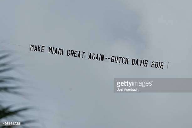 A banner asking the University of Miami to rehire Butch Davis is flown prior to game between the Miami Hurricanes and the Georgia Tech Yellow Jackets...
