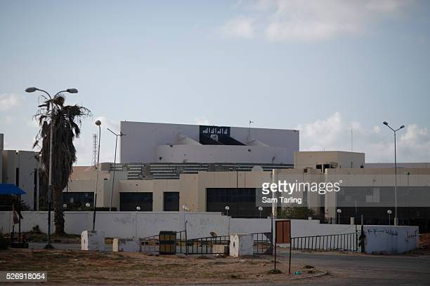 Banner associated with the Islamic State has been painted on the front of the Ougadougou conference centre, which is currently occupied by militants...