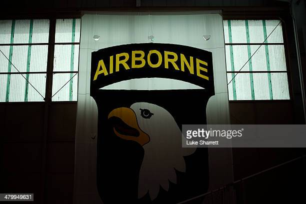 Banner bearing the Screaming Eagle insignia of the 101st Airborne Division hangs in a hangar at Campbell Army Airfield March 21, 2014 in Fort...