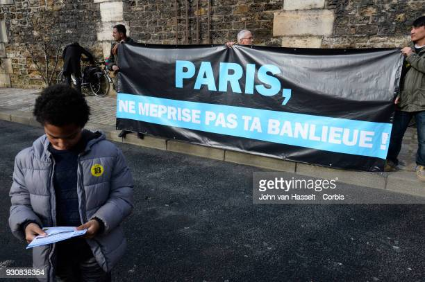 A banner by protestors opposing the Paris mayor's decision to limit cars in the capital until a better infrastructure of public transportation to and...