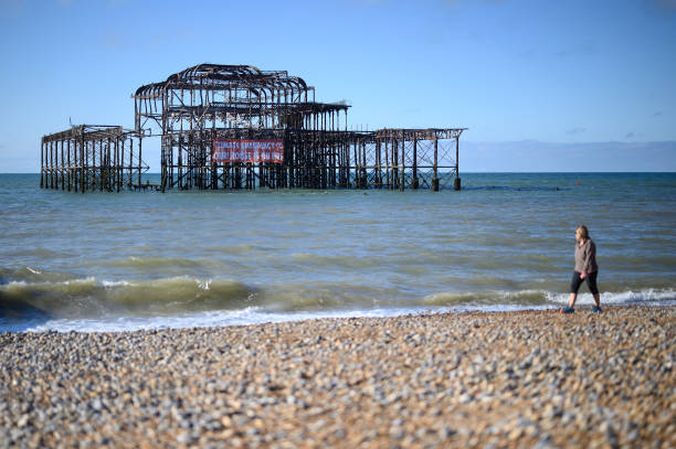 GBR: XR Unfurl Protest Banner On Brighton's West Pier Ahead Of Labour Conference